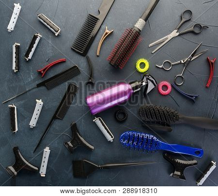 Top view of professional hair dresser tools on black concrete background poster