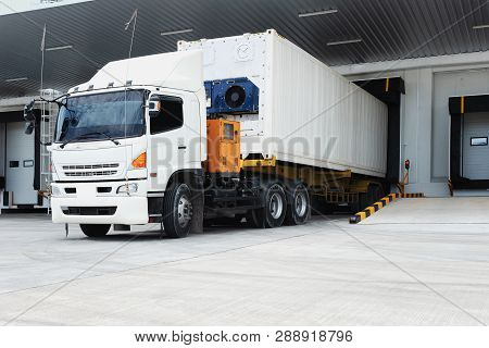 Refrigerator Truck Freezing Food. Transporting Goods In The Loading Goods Of The Freezing Warehouse.
