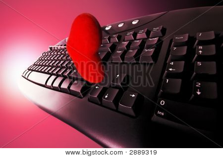 Concept Love Dating Friendship Relationship Romance on the Internet (a flying keyboard and a heart in purple and magenta tint with radial red and magenta tint background) poster