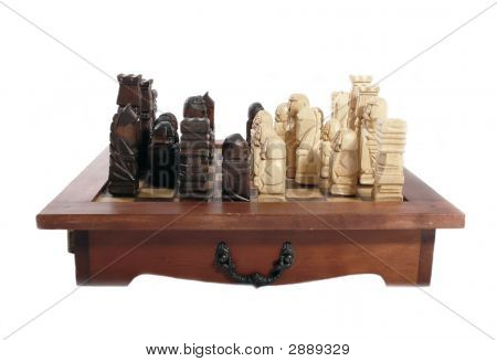 Wooden Carved Chess Pieces On White Background