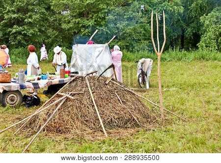 Rest After Haymaking. Mow The Grass By Hand. Summer, Haymaking, Haystack. Mowing Grass Is A Slanting