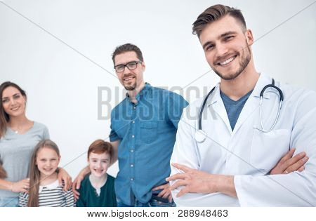 smiling family doctor and his patients