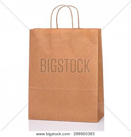 One Empty Brown Paper Bag. Recycled paper Shopping Bag isolated on white background.