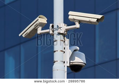 Three Cctv Security Cameras On Street Pylon