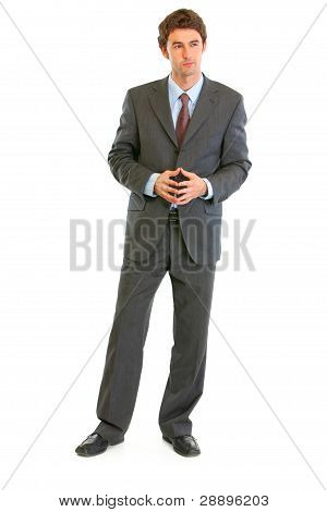 Full Length Portrait Of Confident Modern Businessman