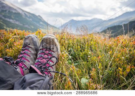 Alpine Boots In Foreground, Idyllic Mountain Landscape In The Blurry Background