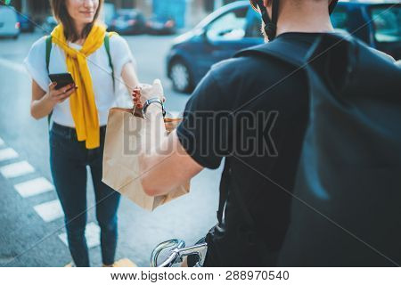 Male Courier With Bicycle Delivered No Name Shopping Bag To The Client.courier Delivery Food Service