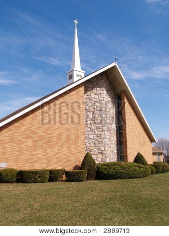 Modern Brick Church With White Steeple