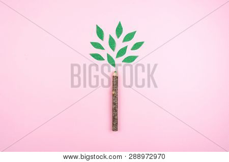 Ecological friendly, sustainable environment, Eco conscious concept with pen in the form of a tree trunk with green leaves on pink background. poster