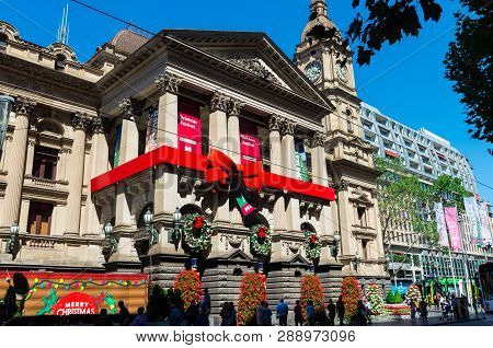 Melbourne, Australia - December 23, 2018: Melbourne Town Hall Decorated With Christmas Ribbon And Wr