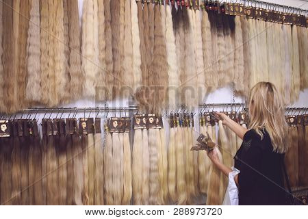 Kiev, Ukraine - 19 September, 2018: Women Choose Clip-in Hair Extensions Equipment Of Natural Hair.