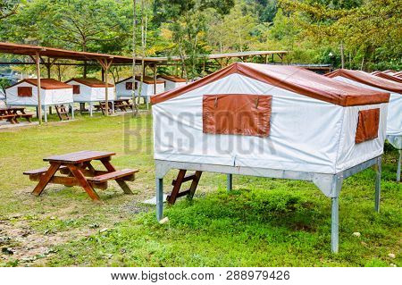 Elevated stationary tents on metal platforms at asian style campsite in Taiwan poster