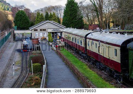 Betws Y Coed, Uk - Feb 2, 2019: The Miniature Train Of Betws Y Coed Railway Museum Operating Alongsi