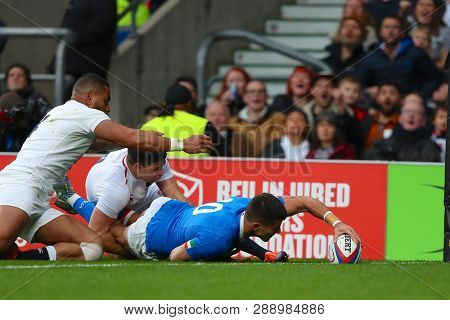 LONDON, ENGLAND - MARCH 09 2019: Tommaso Allan of Italy scores a try during the Guinness Six Nations match between England and Italy at Twickenham Stadium