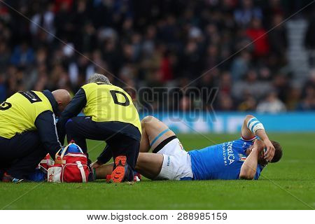 LONDON, ENGLAND - MARCH 09 2019: Tommaso Castello of Italy gets treatment for an injury during the Guinness Six Nations match between England and Italy at Twickenham Stadium