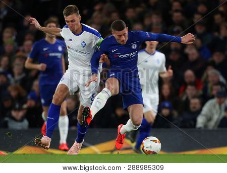 LONDON, ENGLAND - MARCH 7 2019: Serhiy Sydorchuk of Dynamo Kiev and Ross Barkley of Chelsea compete during the Europa League match between Chelsea and Dynamo Kyiv at Stamford Bridge.