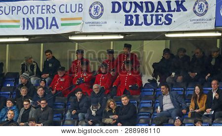 LONDON, ENGLAND - MARCH 7 2019: Members of the Royal Hospital Chelsea (Chelsea Pensioners) watching the Europa League match between Chelsea and Dynamo Kyiv at Stamford Bridge.