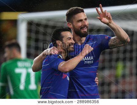 LONDON, ENGLAND - MARCH 7 2019: Pedro of Chelsea celebrates scoring a goal with Olivier Giroud during the Europa League match between Chelsea and Dynamo Kyiv at Stamford Bridge.