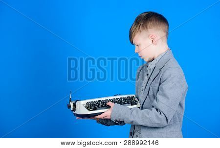 How Does A Retro Typing Machine Work. Smart Child Using Retro Technology. Cute Boy With Typewriter.