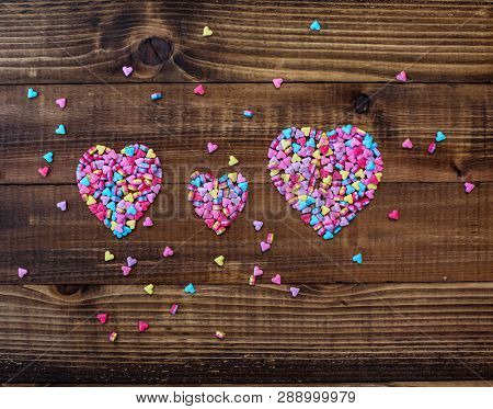 Sweet hearts on wooden background