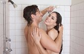 Loving affectionate nude young heterosexual couple in affectionate sensual kiss after taking shower. Mid adult Caucasian men in late 30s and young Latina woman in early 20s poster