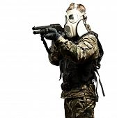 portrait of young soldier with gas mask aiming with shotgun poster
