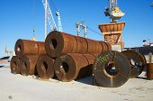 iron  roll in cargo port whit ship poster