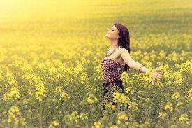 Happy Beautiful Woman In Free Summer Love Of Youth Wellbeing. Attractive Young Beauty Girl Enjoying