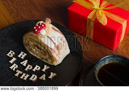 Beautiful And Delicious Pastry With A Birthday Gift