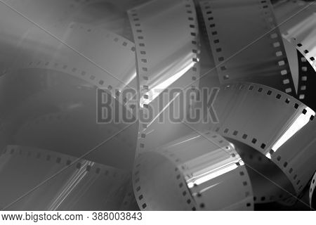 35mm Film In Black And White. Abstract Blurry Background With Photographic Film. Black And White Bac
