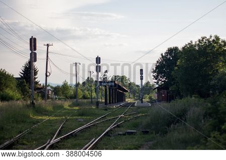Train Station In Radauti, Romania. Railway Line At The Train Station With Nature Around With Cloud O