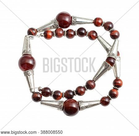 Handcrafted Necklace From Brown Agate And Ox's Eye Beads And Silver Inserts Isolated On White Backgr