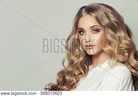Beautiful Young Blonde Woman Fashion Model With Long Healthy Curly Hairstyle