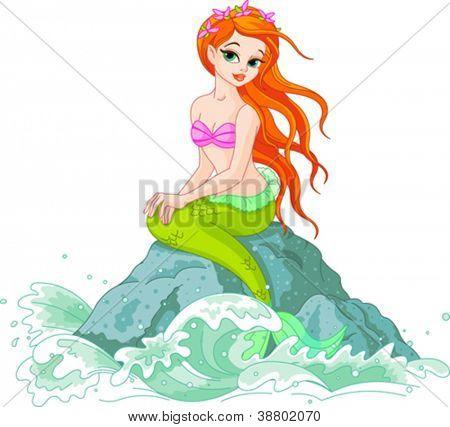 Beautiful mermaid girl sitting on the rock