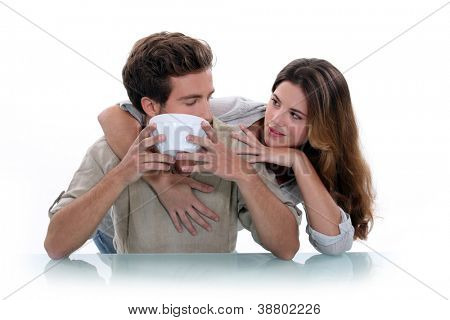 Woman embracing man with bowl