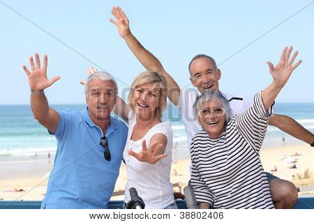 group of senior people on the beach