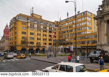 Lima, Peru - December 4, 2008: Plaza Peru With Fountain And Flag Surrounded By Yellow Tall Buildings