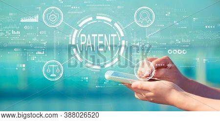 Patent Concept With Person Holding A White Smartphone