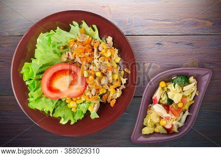Salad With Chicken Stomachs With Carrots And Corn And Salad On Brown Plate With Vegetable Salad Top