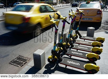 Bucharest, Romania - September 01, 2020: Several Splash Electric Scooters Are Parked On A Sidewalk I