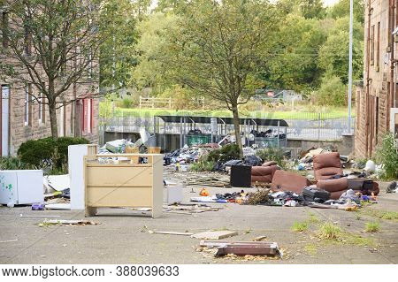 Poor Council Flats With Fly Tipping Of Rubbish Outdoors Inverclyde Scotland