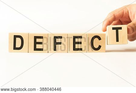 Word Defect. Wooden Small Cubes With Letters Isolated On White Background With Copy Space Available