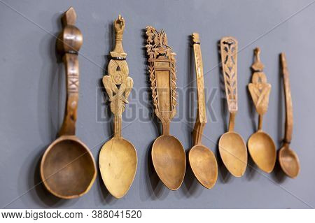 Different Carved Wooden Spoons Are Seen Arranged.