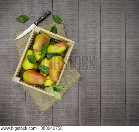 A Wood Crate Full Of Pears. Fragrant Yellow Pears And Leaves. Autumn Time. Healthy Organic Pears. Ju