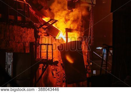 Metal Casting Process In Metallurgical Plant.liquid Metal Pouring Into Ladle For Casting