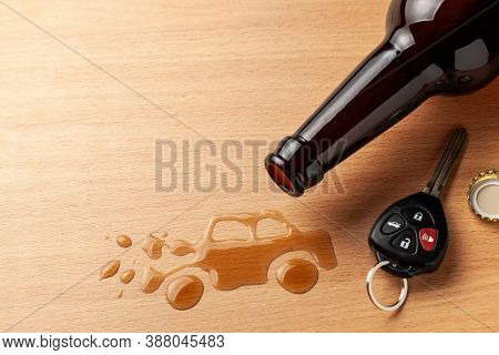 Drunk Driving. Accident With A Broken Car From Alcohol. Beer Bottle And Car Keys. Broken Car