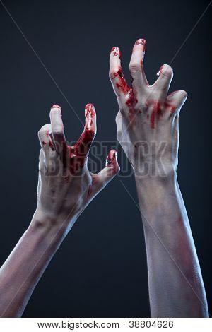 Creepy zombie hands, extreme body-art, studio shot