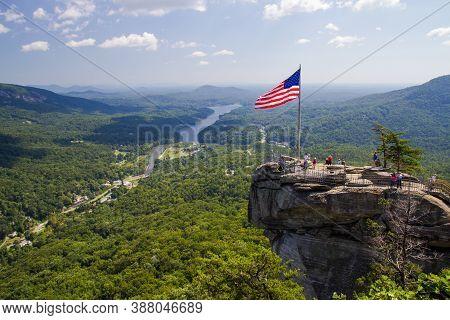 Lake Lure, North Carolina, Usa - September 21, 2014: The Peak Of Chimney Rock Overlooking Lake Lure