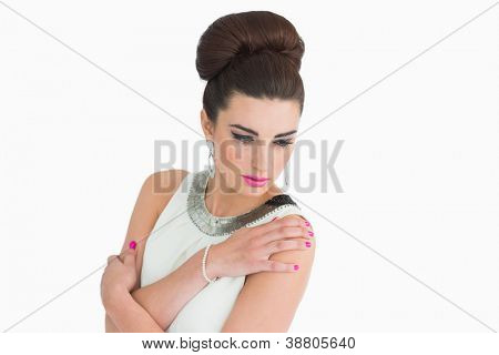 Woman posing in sixties mod style on white background