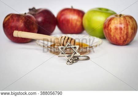 Rosh Hashanah Concept Image - Colorful Apples, A Dish With Honey And Honey Stick, David Star Key Cha